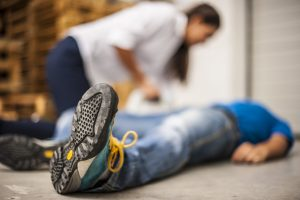 Woman attending collapsed man
